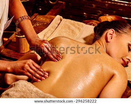Young woman having Indian spa treatment. - stock photo