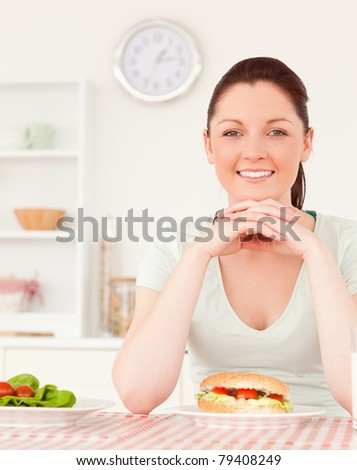 Young woman having lunch in her kitchen