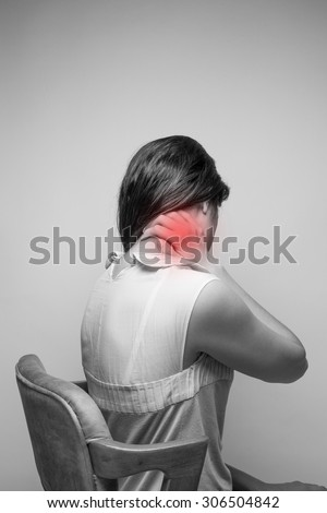 Young woman having pain in the neck,Pain in the neck - stock photo
