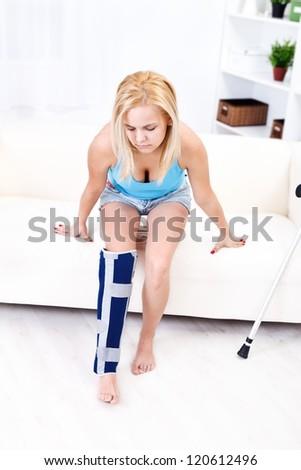 Young woman having painful leg injury - stock photo