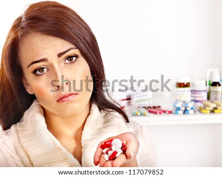 Young woman having pills and tablets. - stock photo