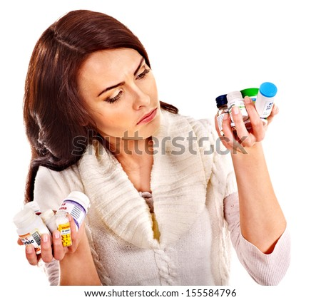 Young woman having pills and tablets. Isolated. - stock photo