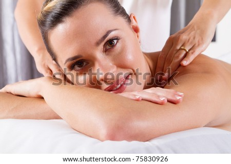 young woman having shoulder massage - stock photo