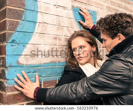 Young woman having trouble with a man - stock photo