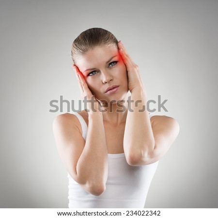 Young woman having vertigo problem or brain disease. Pretty Caucasian female touching her painful temples.  - stock photo