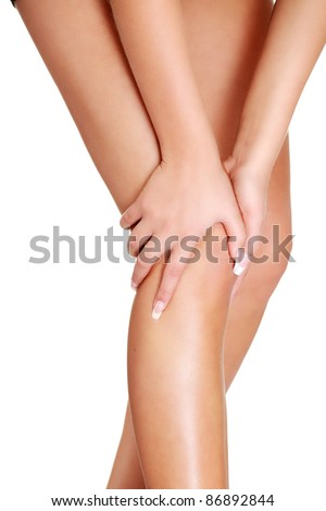 Young woman heaving leg injury isolated on white - stock photo