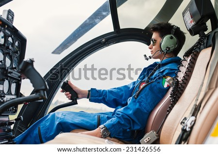 Young woman helicopter pilot. - stock photo