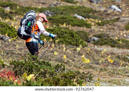 Young woman hiker hiking in mountains, Himalayas Nepal - stock photo