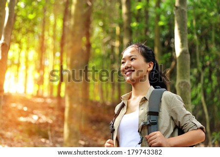 young woman hiker in mountain forest - stock photo