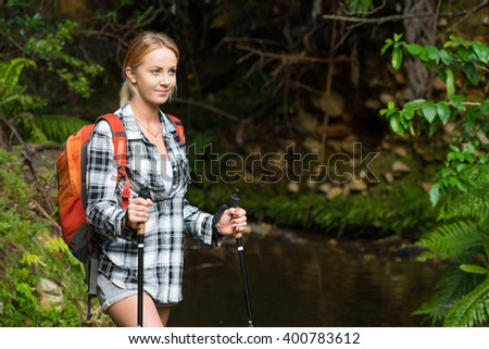 Young woman hiking in the bush - stock photo
