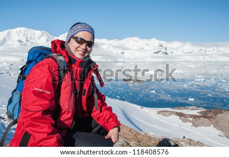 Young woman hiking with backpack in mountains, Antarctica - stock photo
