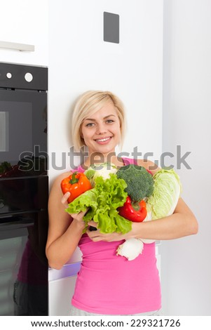 young woman hold raw fresh vegetables refrigerator, diet healthy organic vitamin food concept, pretty girl smile at home modern kitchen