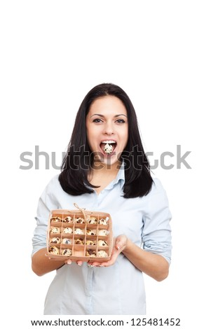 young woman hold raw quail egg in open mouth teeth, female happy smile, isolated on white background natural organic food concept