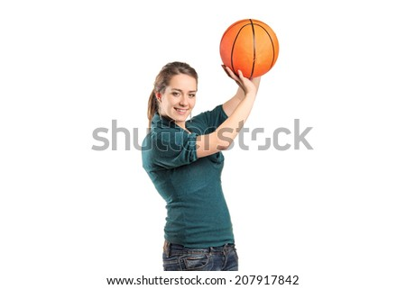 Young woman holding a basketball isolated on white background - stock photo