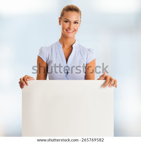 Young woman holding a blank board - stock photo