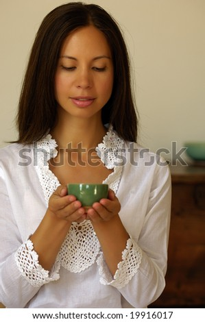 Young woman holding a bowl - stock photo