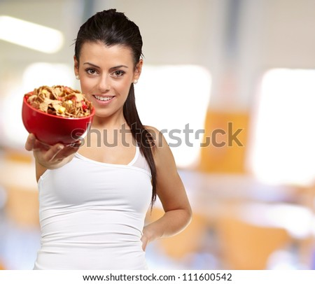 Young woman holding a cereal bowl, indoor - stock photo