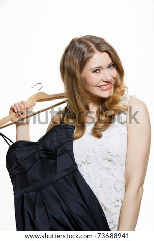 young woman holding a dress in her hand - stock photo