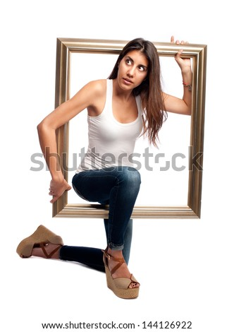 young woman holding a frame isolated on a white background - stock photo