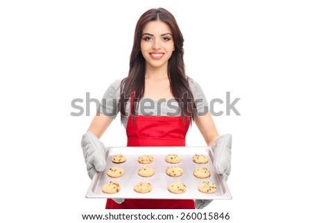 Young woman holding a pan full of chocolate chip cookies isolated on white background - stock photo