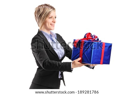Young woman holding a present isolated on white background - stock photo