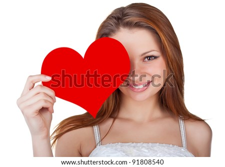 Young woman holding a red heart, isolated on white background