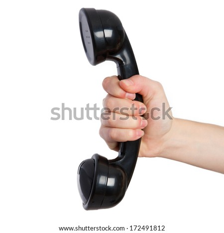 young woman holding a vintage phone - stock photo