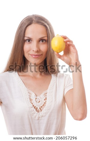 young woman holding a yellow lemon