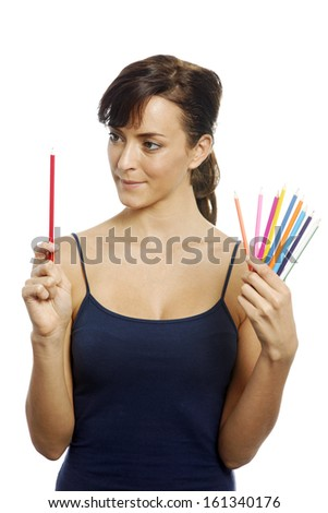 Young woman holding an assortment of colouring pencils