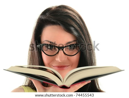 Young woman holding an open book isolated on white. - stock photo