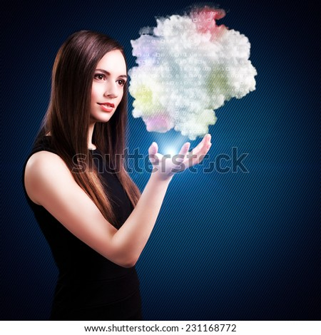 young woman holding and viewing a cloud of data - stock photo