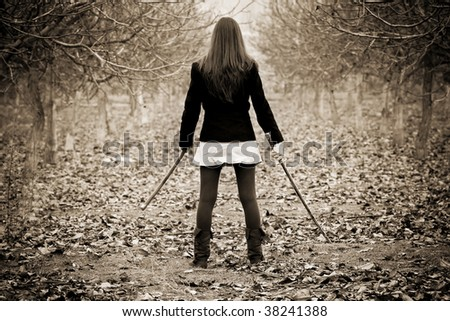 Young woman holding asian sword - stock photo