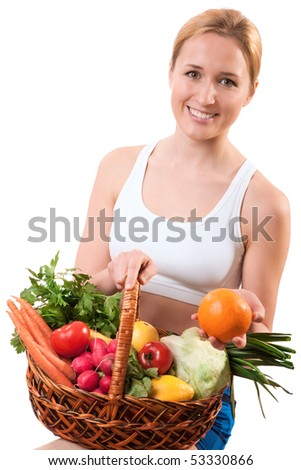 young woman holding basket of vegetables