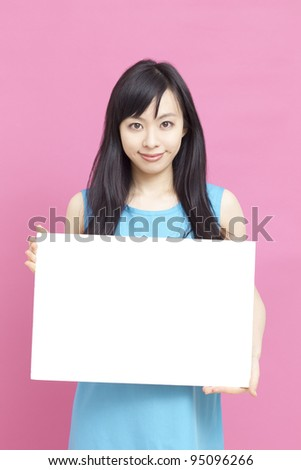 Young woman holding blank billboard. - stock photo