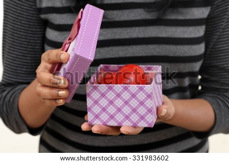 Young woman holding boxes against white - stock photo