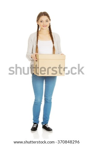 Young woman holding carton box. - stock photo