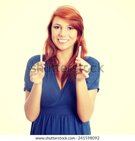 Young woman holding cigarette and electronic cigarette. - stock photo
