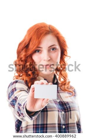 young woman holding credit card isolated on white background - stock photo