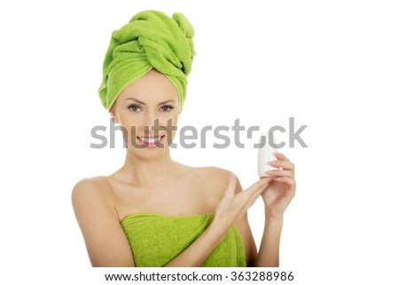 Young woman holding deodorant. - stock photo