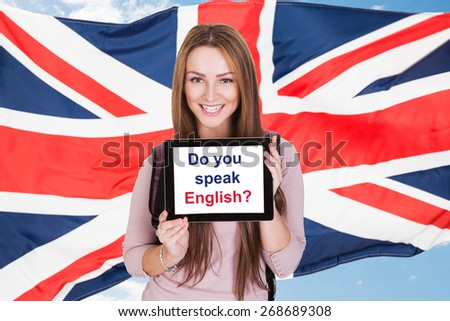 Young Woman Holding Digital Tablet Asking Do You Speak English In Front Of British Flag