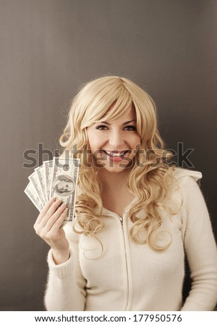 Young woman holding 500 dollars  - stock photo