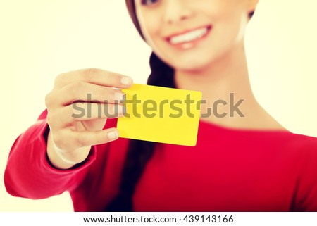 Young woman holding empty business card - stock photo