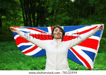 Young woman holding flag of Great Britain