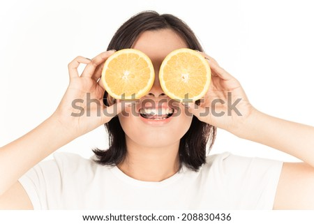 Young woman holding fresh oranges. Healthy eating. Isolated over white.