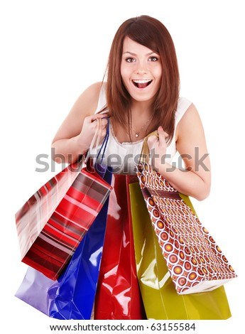 Young woman holding group shopping bag. Isolated