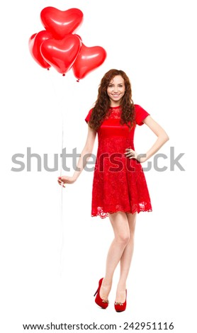 Young woman holding heart-shaped balloons, Valentine day concept, isolated over white - stock photo