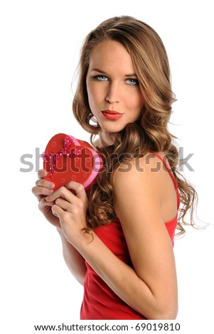 Young woman holding heart shaped gift isolated over white background