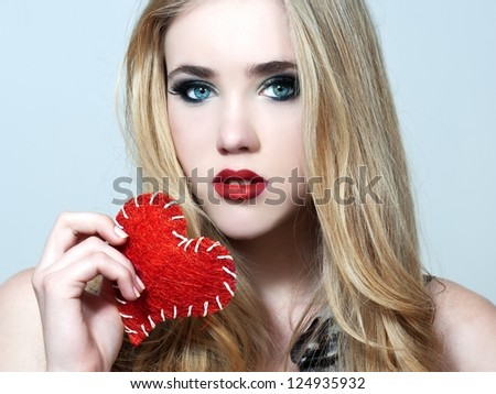 Young woman holding heart. Valentines day