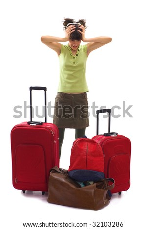 Young woman holding her head with hands because of  huge and a lot of luggages - stock photo