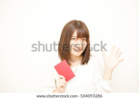 Young woman holding her passport with smile